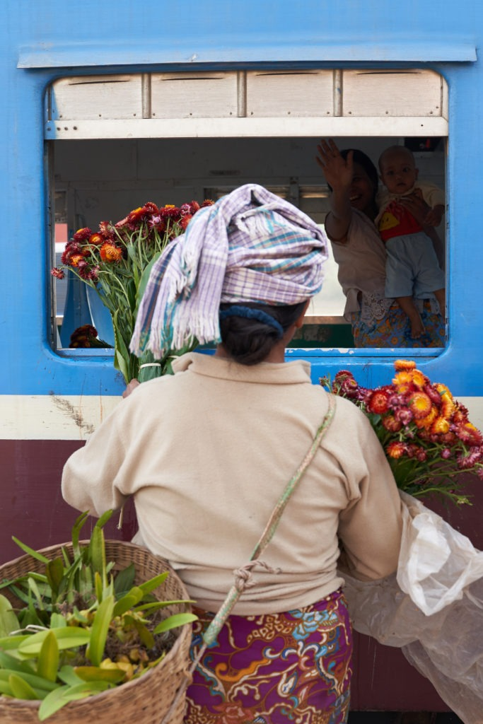 Selling flowers to train passengers
